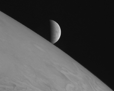 Europa rising over Jupiter. Source: NASA-JPL